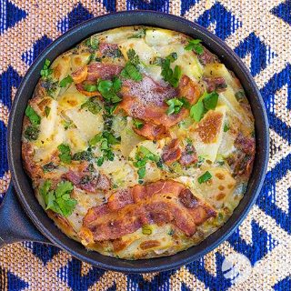 Crispy bacon frittata recipe with spring onion and parsley. Short video included.